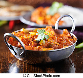 indian chicken vindaloo curry in balti dish