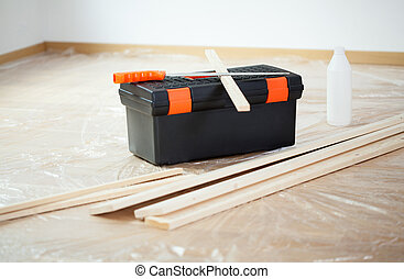 Work tools for a house renovation in empty room