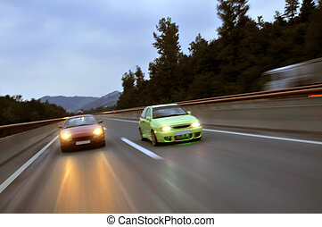 Tuning cars racing down the highway - Fast tuning cars...
