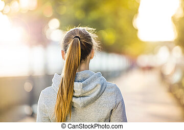 Sporty woman during morning walk - Young sporty woman...