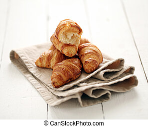 Fresh french croissants on a tablecloth - Fresh homemade...