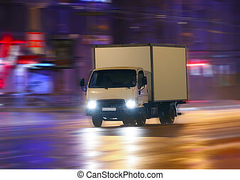truck moving on night city - truck moving in rain on night...