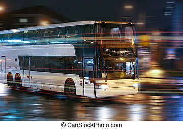 bus moves in the night city - tourist bus moves in the night...