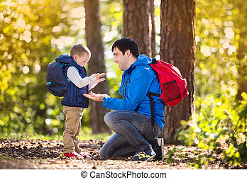 Father and son in the forest - Father and son enjoying a...