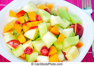 Fruit salad - Plate with fruit salad on table