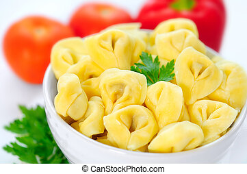 Tortellini - Bowl with tortellini on background