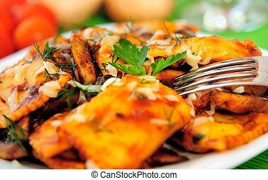 Ravioli - Plate with ravioli on table