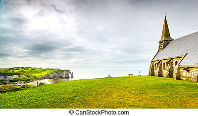 Etretat village, Church and Aval cliff. Normandy, France. -...