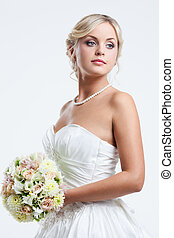 Young bride - Young blond lady wearing wedding dress and...