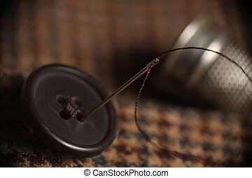 Sewing button on a tweed coat