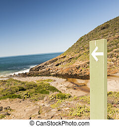 Sign Post - Sign post pointing toward the coastline of...