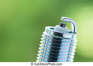 Auto service. New spark plug as spare part of car. - Auto...