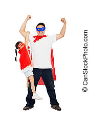 asian little girl hanging his father arm with superhero suit...