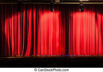 Big red curtain - a closed red stage curtain in a small...