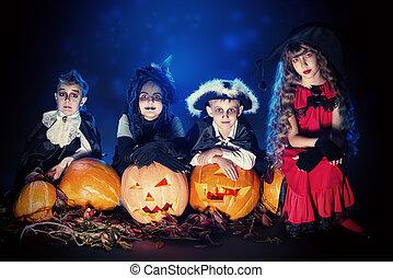 satanic children - Cheerful children in halloween costumes...