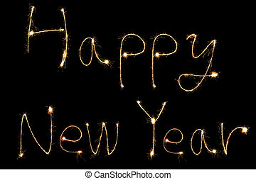 burning sparkler stick and writing happy new year words -...