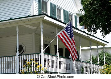 american flag at corner of porch