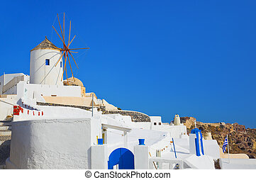 Windmill in Oia at Santorini, Greece - vacation background