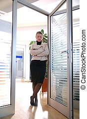 young businesswoman posing in office | new perspecitves...