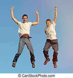 Tennage Boys jumping - Toned photo of Two Happy Tennage Boys...