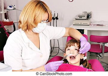 dentist and little girl patient