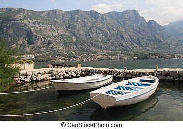 Two fishing boats and a small dock in Montenegro in the Bay...