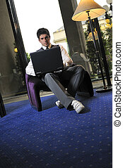 young adult working on laptop
