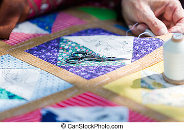 Handmade craft - Handmade quilt from vintage fabric.