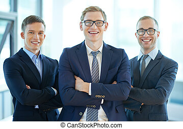 Confident male team - Three confident business workers...