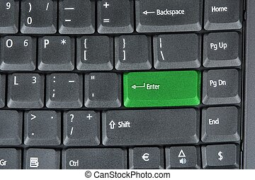 Computer keyboard with  green key, technology background