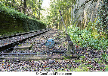 Old railroad track switch with train background - Old...