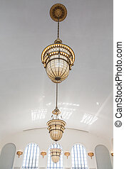 Ornate Old Lamps Hanging from White Ceiling