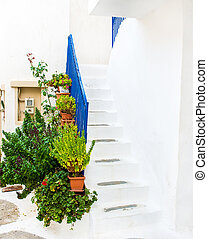Greek island street with colorful shutters and doors.