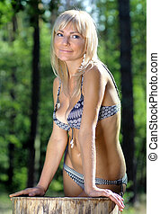 blonde woman in the foliage - beautiful blonde woman in the...