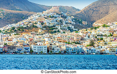 Greek island with colorful houses and yachts