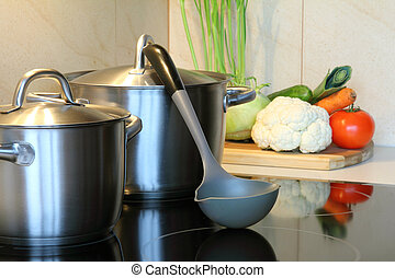 healthy soup with vegetables in the kitchen , pot on...