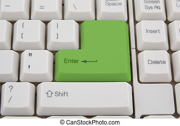 Computer keyboard with  green key, as background