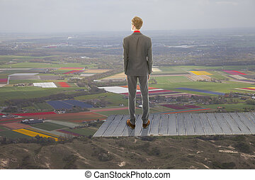 Young business man looking at landscape