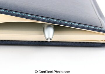 Pen with close notebook