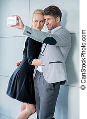 Stylish young couple taking a self-portrait - Stylish young...