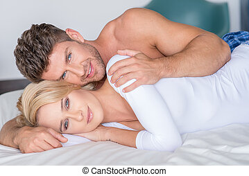 Sweet Young Lovers Lying on Bed Looking at Cam - Close up...