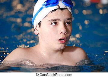 .boy in swimming pool - children have fun on swimming pool