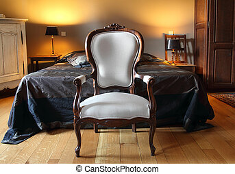 Vintage armchair on old hotel room , vintage apartment