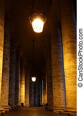 details from the columns of piazza di san pietro at night, Rome