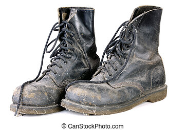 old dirty boots - old and dirty boots isolated on white...