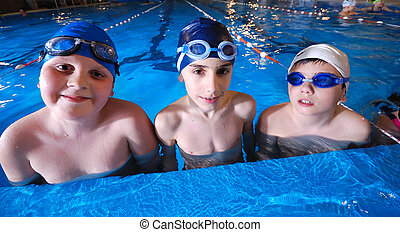 childrens in serie at swimming pool - children group at...