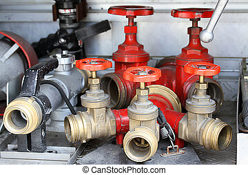red Sleeve valves and fire lances of trucks of firefighters...