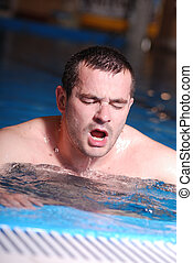 man in swimming pool - mana have sport training and...