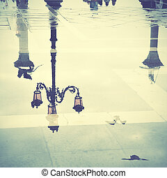Venice in puddle - Venice reflects in puddle, Saint Marks...