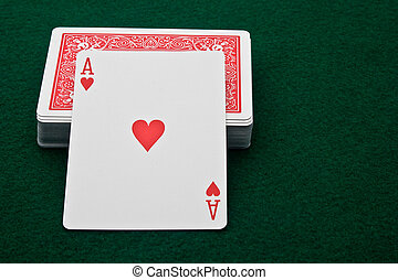 Ace of Hearts - Ace of hearts leaning on deck of cards on...